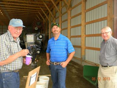 Cousin Charlie (in blue) farms just down the road. He is talking with Alton & Uncle Jim